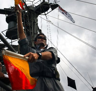 ABCIS James O'Keefe performing Cemaphore onboard HMAS SUCCESS